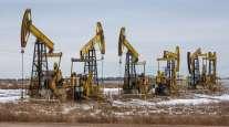 Oil pumping jacks operate in a Russian oilfield in November 2020. (Andrey Rudakov/Bloomberg News)