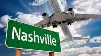 Plane flying over Nashville sign
