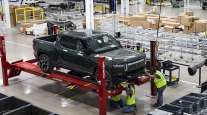 An RT1 truck is assembled and tested on the factory floor at the Rivian factory in Normal, Ill.