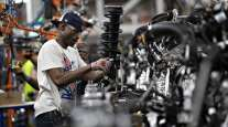A worker assembles a vehicle component at the Ford Motor Co. Chicago Assembly Plant. (Daniel Acker/Bloomberg News)