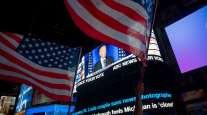 News that Joe Biden is projected winner of the U.S. presidency shows on a screen in New York on Nov. 7.