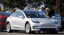 Tesla sedan at a dealership