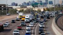 Early rush hour traffic rolls along I-10 in Phoenix on Jan. 24.