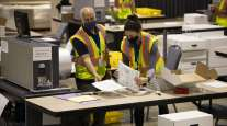 Officials count votes at a convention center in Philadelphia on Nov. 4.