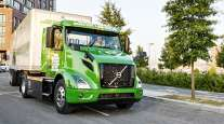 Volvo VNR Electric model making a delivery