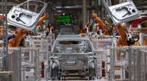 Robots work on the body of a VW ID.3 car at the company's plant in Zwickau, Germany.