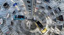 Volkswagen electric vehicles stand inside a delivery tower in Wolfsburg, Germany.
