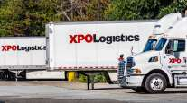 XPO Logistics tractors and trailers sit at a distribution point in San Francisco bay in July 2019.