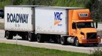 In 2018 a Yellow truck pulls YRC and Roadway trailers