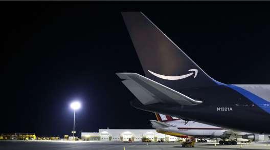 An Amazon Prime Air cargo jet sits parked at Cincinnati/Northern Kentucky International Airport.