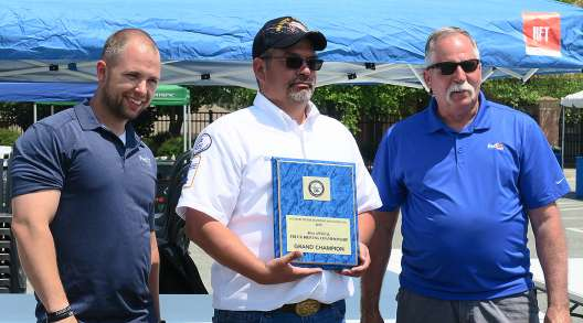 Walmart's Robert Benton (center) wins Delaware's Grand Champion honors for 2019