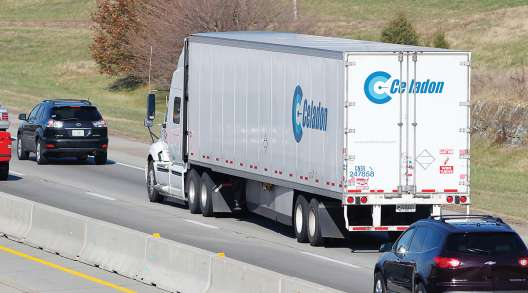 Celadon truck on a highway