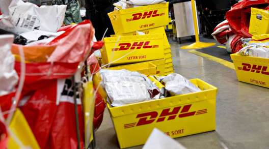 An employee sorts packages at a DHL Worldwide Express facility in Chicago. (Daniel Acker/Bloomberg News)