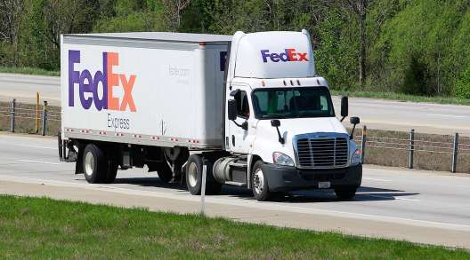 A FedEx Express truck on a highway in Kentucky