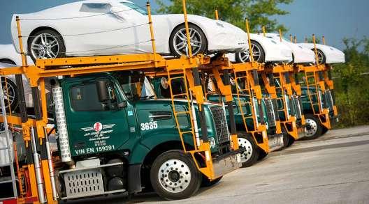 Jack Cooper truck hauling Corvettes