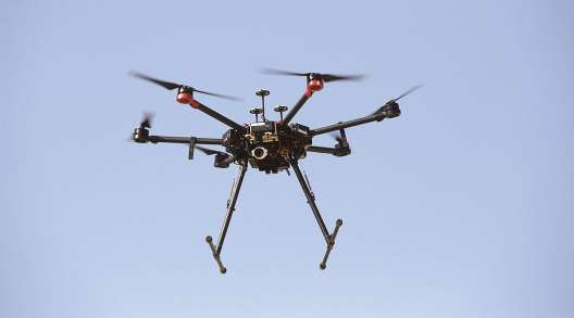 Drones could be used to distribute COVID-19 vaccines to remote areas off Florida's coast. (Kobi Wolf/Bloomberg News)