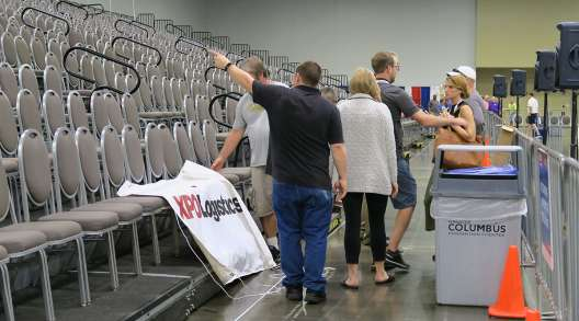 Workers organize banner placement at NTDC