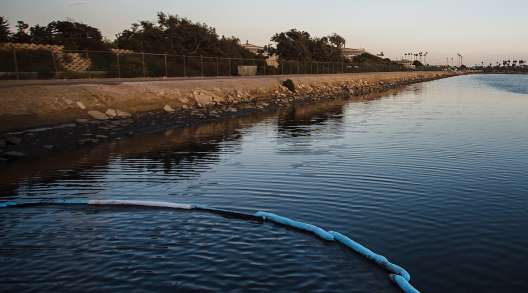 A containment boom at Talbert Marsh during an oil spill in Huntington Beach, Calif.