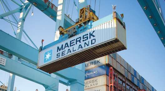A shipping container is off-loaded at the Port of Los Angeles.