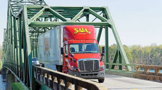Saia truck crosses bridge