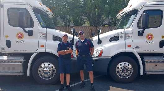 Southern Glazer's drivers by their trucks