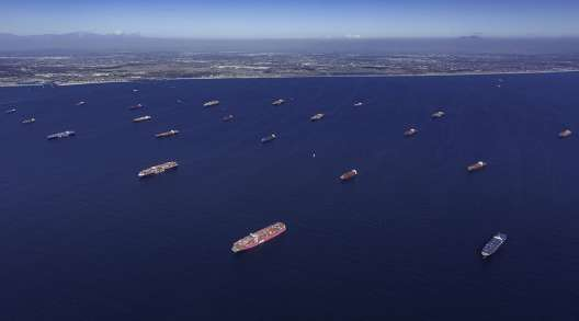 Containerships moored off the ports of Los Angeles and Long Beach, Calif.