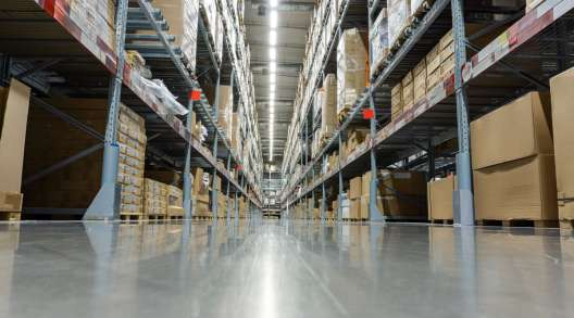 Shelves with boxes sit in a modern warehouse. (Chokii Ns/Getty Images)