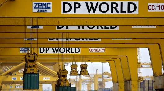 Cranes offload containers at a port terminal in Dubai, United Arab Emirates. (Kamran Jebreili/Associated Press)