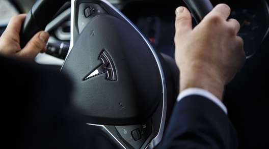 The steering wheel of an Uber Technologies Tesla Model S electric automobile