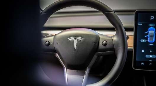 The steering wheel of a Tesla Inc. Model 3 electric vehicle