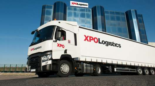 XPO Logistics truck in front of company headquarters