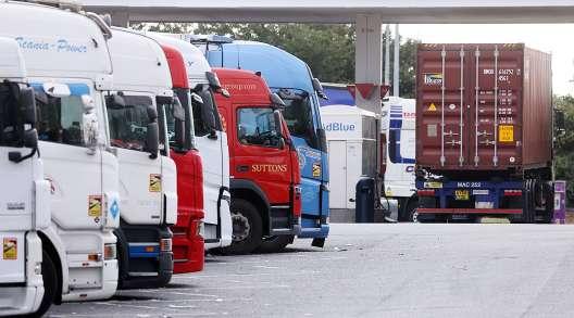 A row of trucks at a service station near Thurrock, U.K.