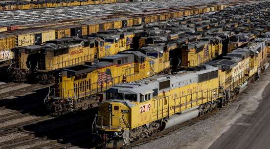 Union Pacific Corp. locomotives and rail cars sit parked at a rail yard in Kansas City.