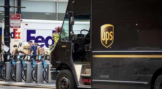 UPS and FedEx trucks