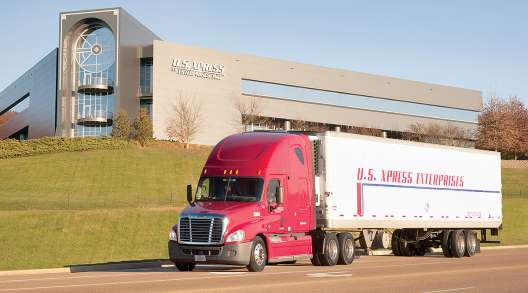 U.S. XPress truck drives by headquarters