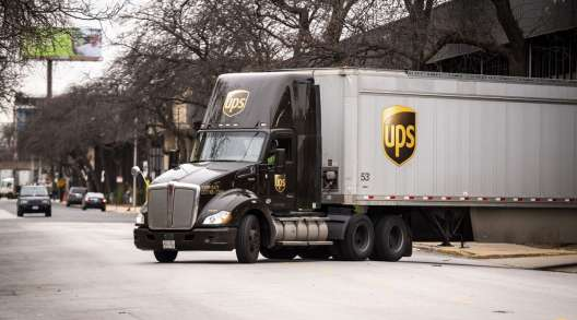 A UPS truck exits a distribution center in Chicago in November 2020. (Christopher Dilts/Bloomberg News)