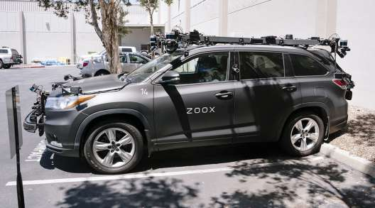 A Zoox Inc. self-driving car sits parked outside the company's headquarters in Foster City, Calif.