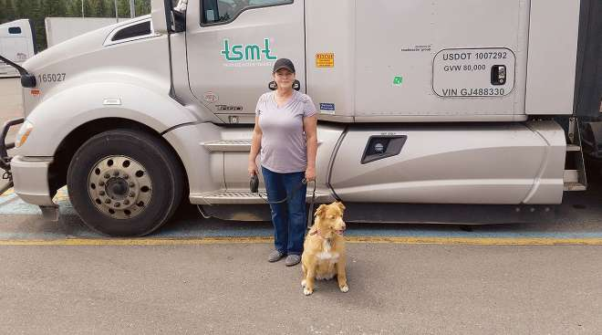 Melissa Metcalfe with one of the two dogs she travels with.