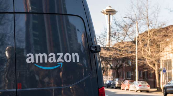 An Amazon Prime delivery van sits parked on a street in Seattle.
