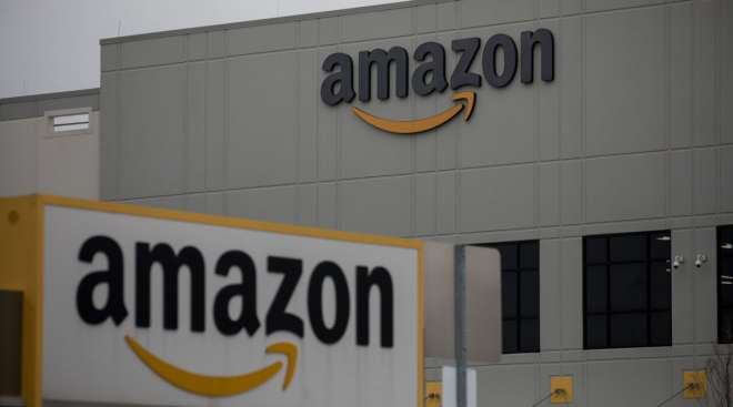 Amazon signage is displayed in front of a company warehouse in Staten Island In March 2020. (Michael Nagle/Bloomberg News)