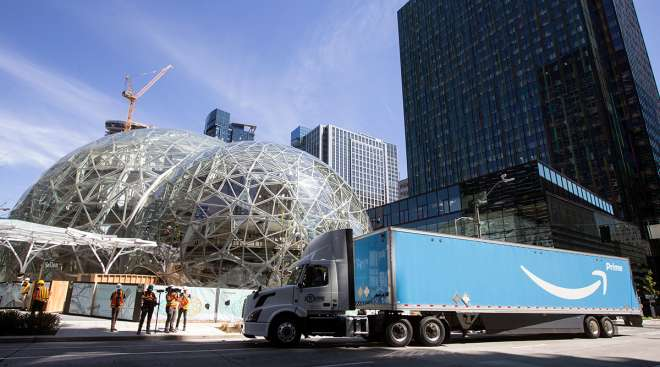 An Amazon Prime truck delivers an Australian fern to Amazon's campus for the ceremonial first planting at The Spheres in Seattle.