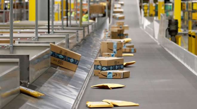 Packages move along a conveyor at an Amazon warehouse facility in Goodyear, Ariz.