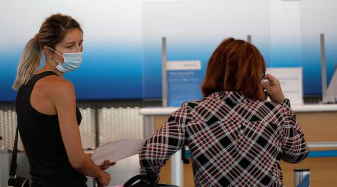 Passengers wait at American Airlines ticket counter
