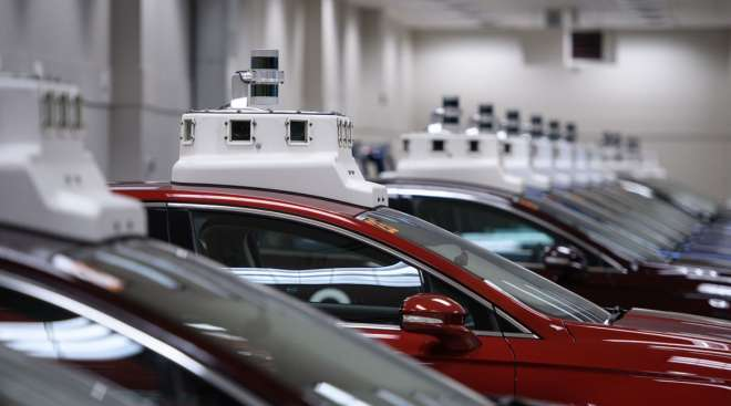 Cameras are seen on the roofs of Argo AI modified Ford Fusion autonomous vehicles.