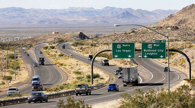 Motorists head northbound toward Las Vegas on U.S. Highway 93, near Kingman, Ariz.