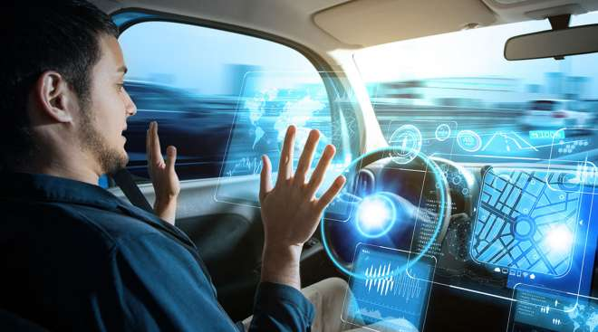 Driver in autonomous car with hands off wheel
