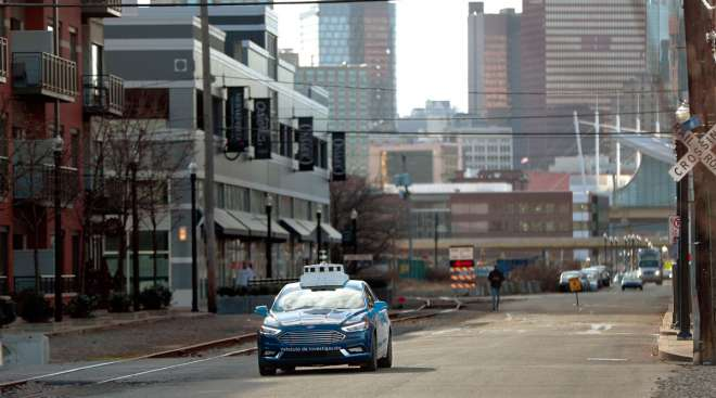 An Argo AI test vehicle navigates Pittsburgh streets in 2018.