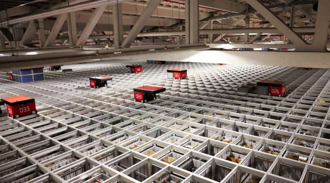 Automated warehouse robots, manufactured by AutoStore, deliver customer orders in Germany.