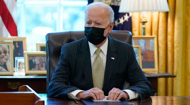 President Joe Biden signs the PPP Extension Act
