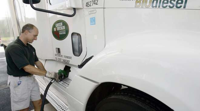 Green Mountain Coffee Roasters driver Todd Jones pumps biodiesel onto a company truck.